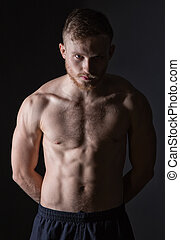 Bearded man with muscular torso