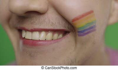 Bearded man with painted lips smiling. LGBT community. Transsexual guy