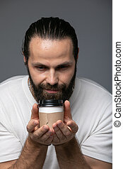Man With Pleasure Inhaling The Smell Of Coffee.