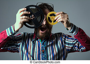 Bearded man with two 16mm film reel