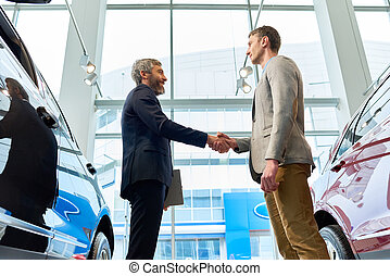 Bearded Manager Selling Cars in Showroom