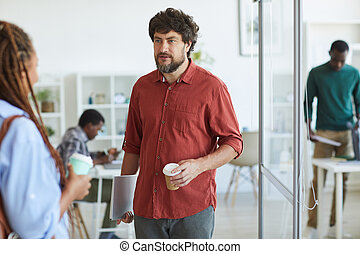 Bearded Manager Talking to Colleague in Office