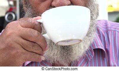 Bearded Old Man Drinking Coffee