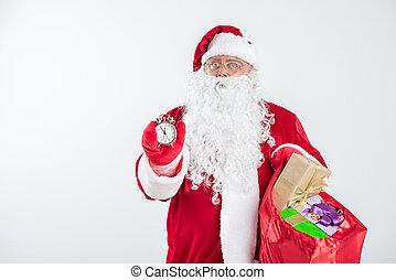 Bearded Santa Claus waiting for midnight