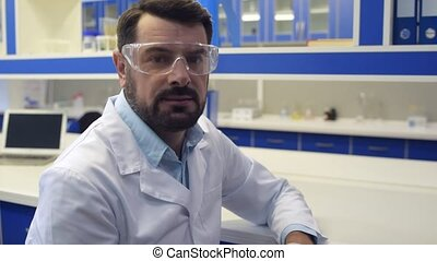 Bearded scientist posing for camera confidently
