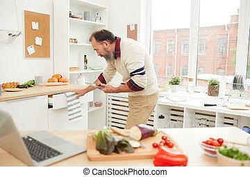 Bearded Senior Man in Kitchen