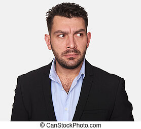 bearded serious man looking away. Isolated