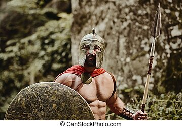Bearded severe warrior in gladiator outfit