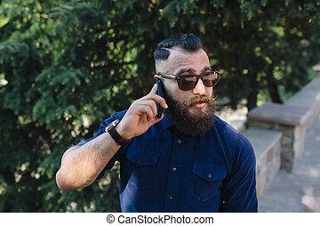 bearded speaks by phone