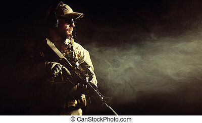 Bearded special forces soldier in the smoke