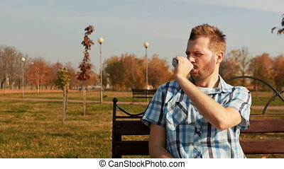 bearded vaper smoking an electronic cigarette and making...