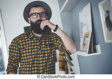 Bearded young man at home office