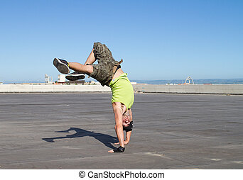 beat boy dancing outdoors
