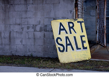 Beat Up Art Sale Sign Board Leaning Against Block Wall Near...