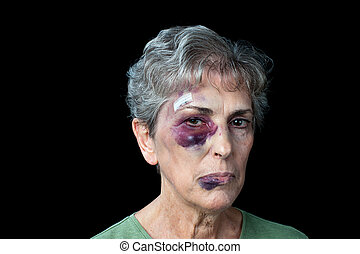 Beaten old woman - An elderly grandmother badly beaten with...