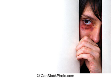 Beaten woman - Beaten bruised woman looking scared from...