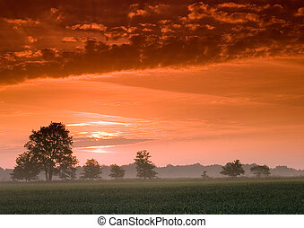 Beatiful and calm sunrise. Colourful landscape.