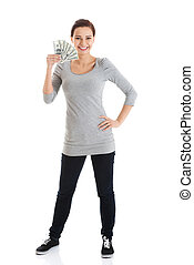 Beatiful casual woman holding money. Isolated on white.