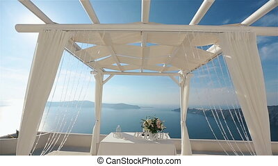 Beatiful elegant wedding tent aisle at coast with sea and...