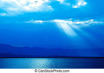 beatiful nature blue picture background mountain lake with god light sky