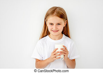 Beatiful schoolgirl kid drinking warm milk