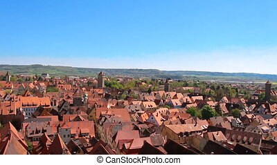 Beatiful view on old red tiled roof tops at bright sunny day...