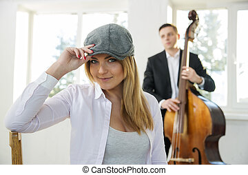 Beatiful woman at sunny day with hat