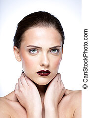 Beaty portrait of attractive woman touching her neck