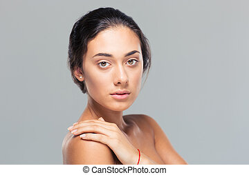 Beaty portrait of attractive young woman looking at camera ...