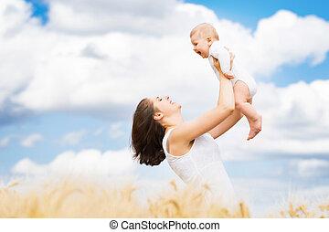 beau, été, nourrisson, femme, pré, elle, concept., wheat., jeune, bébé, jouer