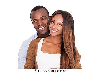 beau, être, quoique, couple, africaine, isolé, jeune, debout, appareil photo, ensemble., blanc, chaque, fin, sourire, autre, heureux