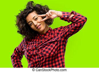 beau, arabe, femme regarde, appareil-photo, par, doigts