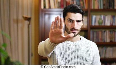 beau, arrêt, jeune, main, sérieux, signe, homme