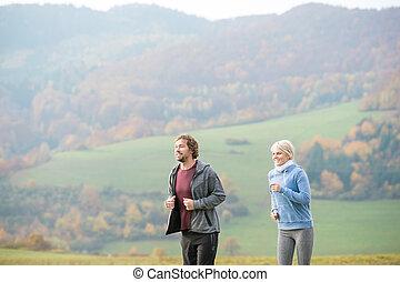 beau, couple, ensoleillé, jeune, automne, courant, nature.
