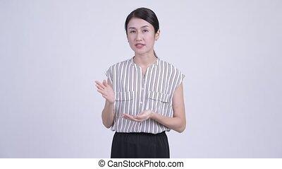 beau, expliquer, quelque chose, femme affaires, asiatique, heureux