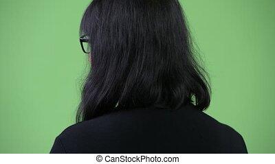 beau, femme affaires, regarder, asiatique, dos