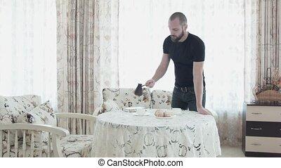 beau, heureux, café, sien, verse, table., après, jeune, couple., mariés, regarde, homme, matin, petit déjeuner, mouvements, croissants., woman., lover., beau
