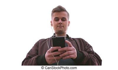 beau, mobile, tient, jeune, téléphone, musique, homme,...