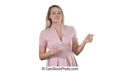 beau, rose, femme, arrière-plan., jeune, conversation, appareil photo, robe blanche, excité