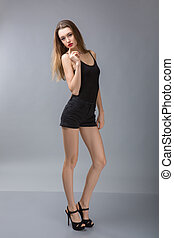 beau, stands, shorts., mince, t-shirt, appareil photo, noir, devant, girl