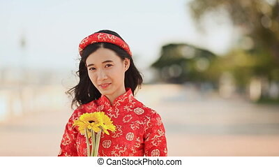 beau, vietnamien, dai, ao, traditionnel, flowers., jaune, girl, robe, rouges