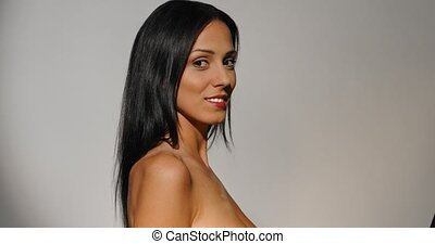 Beaufiful woman is smiling - Woman standing and and looking...