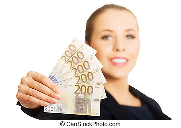 Beauitful woman holding some Euro currency