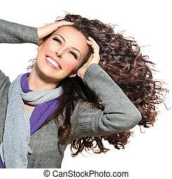 beauté, femme, à, long, bouclé, hair., sain, souffler, cheveux