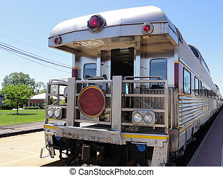 Restored elegant luxury railroad car stopped at a station