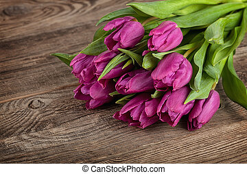 Beauteful tulips on old boards, spring concept