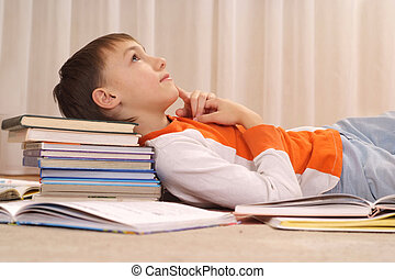 Beauteous boy does homework