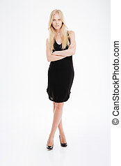 Beautful woman in black dress standing with arms folded
