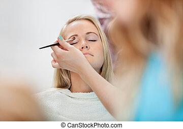 Beautician Applying Eyeshadow - Beautician applying eye...