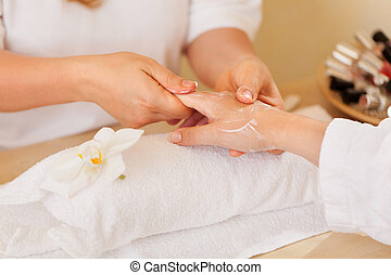 beautician applying lotion